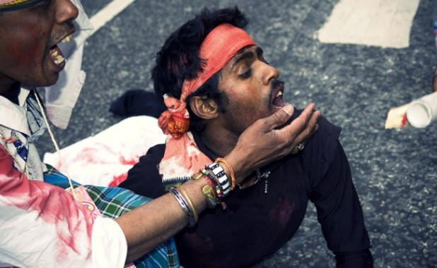 A dramatic recreation of anti-Tamil violence acted out by demonstrators at a 2009  protest in London. Image: CC license, flickr user lewishamdreamer.