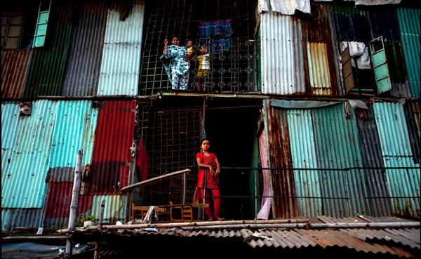 A slum apartment complex in Dhaka flickr/ Zoriah