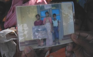 A Rohingya family photo taken by the local authorities as proof of residency in Maungdaw. Those not at home when the photos are taken risk being punished or struck off as a resident.