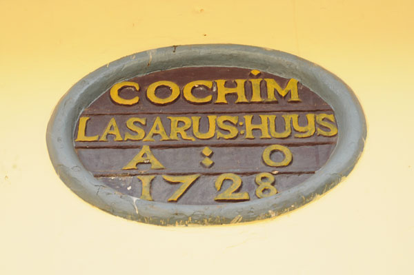 Dutch plaque at Lazarus House, Cochin, dated 1728.