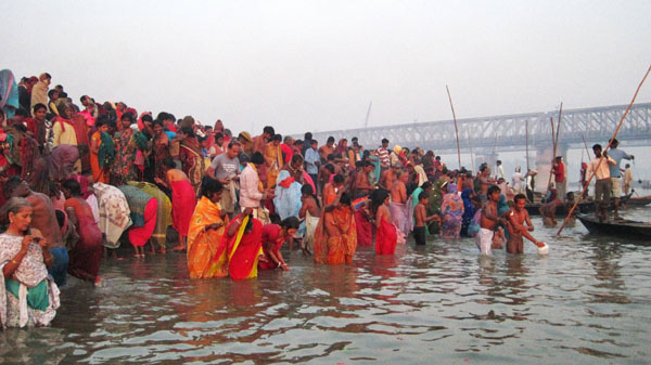 Hindu devotees gather for Ganga-snan, a holy dip at the confluence, on the full moon of Karthik, after which the mela is declared open. Photo: Sharell Cook