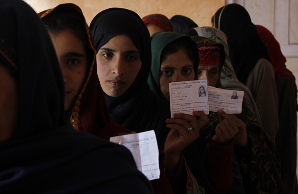 Female voters waiting in queue outside a polling booth in restive Lolab Valley. Click to see more photos.