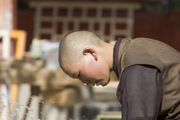 A young nun at the Ani Tshamkhung Monastery  in Lhasa, Tibet. Photo: Luca Galuzzi