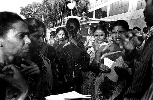 Application forms for scholarships for children of garment workers are distributed by the Garment and Textile Workers' Union in Bangalore.