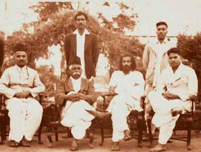 KB Hedgewar, MS Golwalkar (sitting second and third from left, respectively) and other volunteers during an RSS meeting in 1938. Photo: Wikimedia Commons