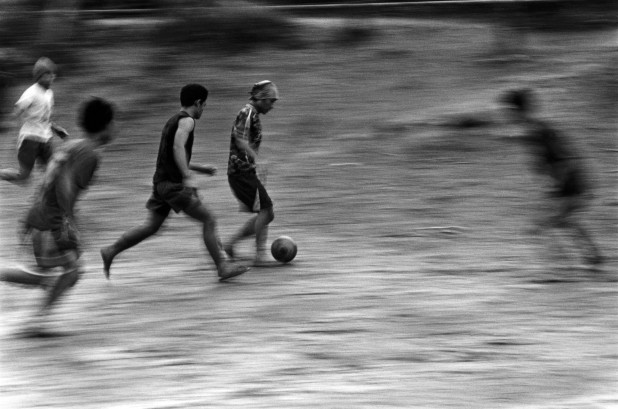 Refugees in Mae La camp in Thailand let off steam during the World Cup in 2006. There are more than 140,000 refugees on the Thai Burma border. Thailand, 2006.