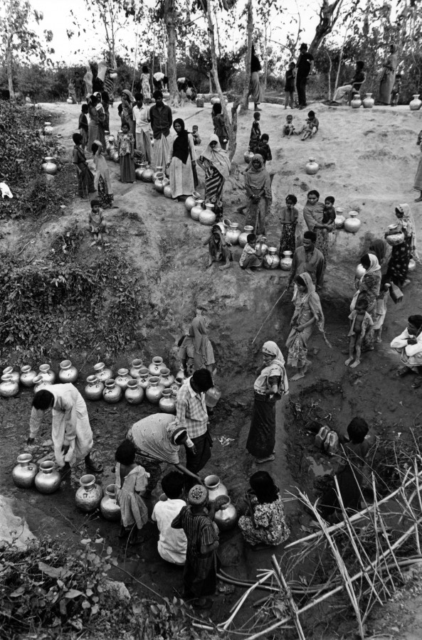 One of the biggest problems faced by the Rohingya in Bangladesh is access to clean water. Water borne parasites and malnutrition are rife and the threat of outbreaks of disease ever present. Here the refugees collect dirty water outside the camp. Teknaf, Bangladesh, March 2007.