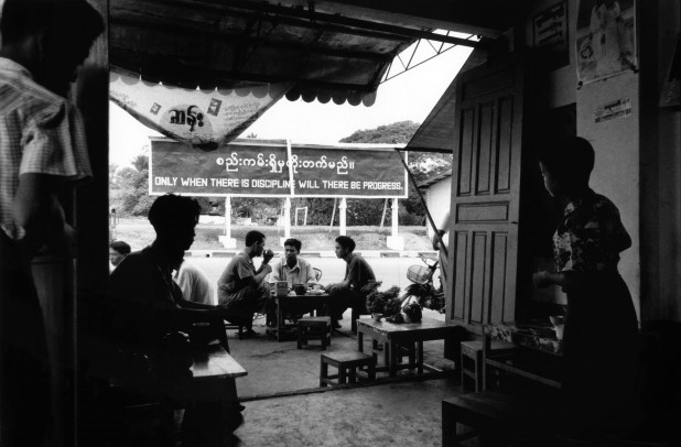 Pa An, Karen state 1998. Teashops are found all over Burma. Traditionally they are meeting places where many discussions and debates take place. The positioning of the signboard in this photograph may be accidental, but the 1988 uprising began after an incident at a teashop in Rangoon.