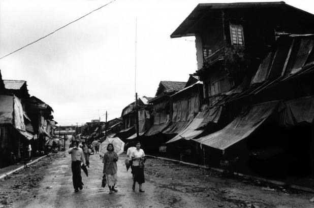 Road widening by the junta in Burma to make way to the new market in Moulmein. The front of the houses were destroyed by the junta and the owners given no compensation. Moulmein, Mon State, Burma, 1996.