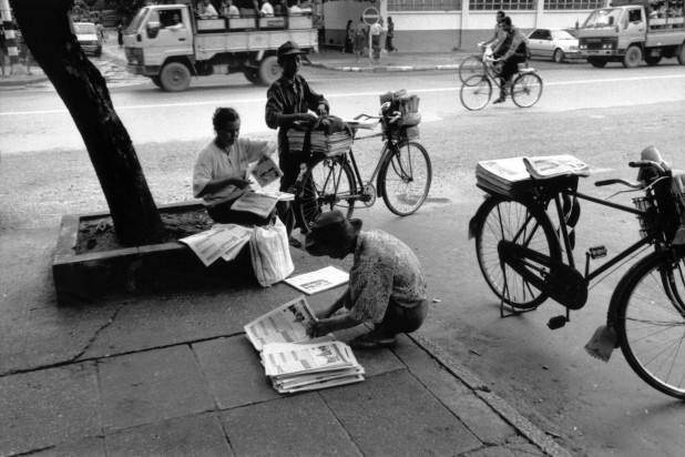 Paper rounds in Rangoon. Burma's media was heavily censored by the Press Registration and Scrutiny Department under the junta. Burma, 1996.