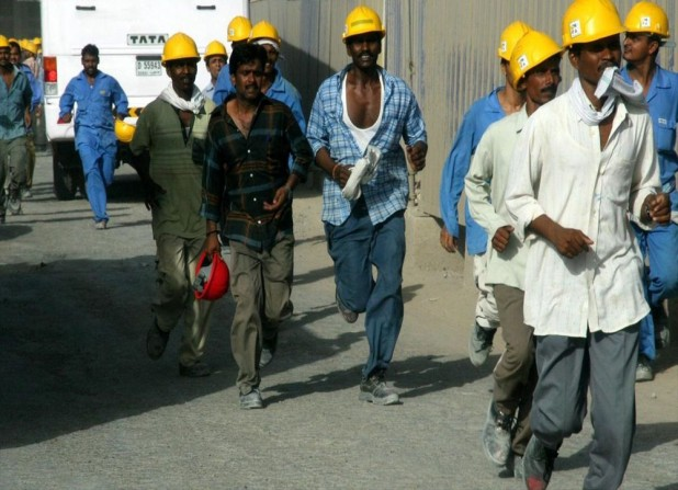 Construction workers at the Burj Dubai. (Photo: Imre Solt, Wikimedia Commons)