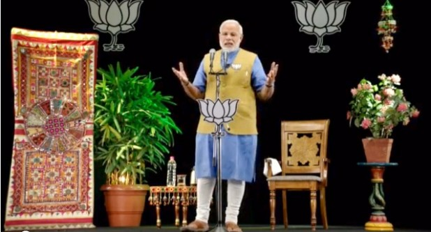 Narendra Modi at the hustings, and in hologram. (Source: Flickr / Narendra Modi)