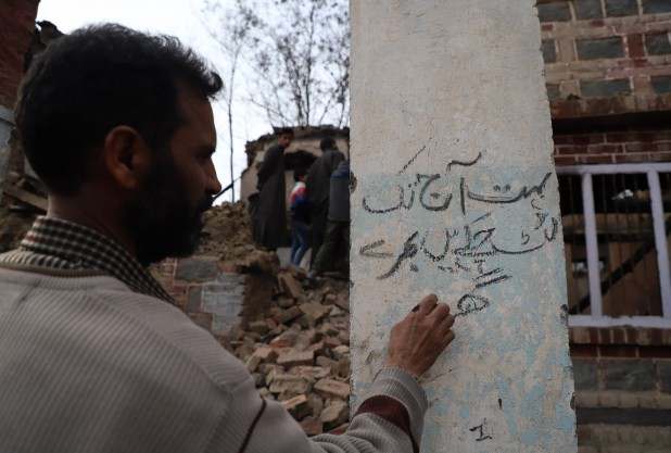 "A couplet on a pillar of his house that Bhat wrote with a piece of charcoal from the rubble. The lines read: ""Countless prosperous homes have been plundered; now the loyal are being butchered."""