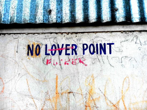 """NO LOVER POINT"" is stamped at many points on the long wall along the path to the masjid. The blue-and-white of the awning is a signature that the Trinamool Congress government leaves everywhere possible in the city. All images by Brinda Bose."