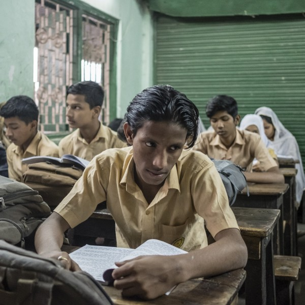 A student during a lesson in the school's camp. There is only one school in Geneva Camp, which is too small to accommodate all of the camp's children.